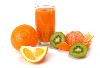 tropical fruits and juice on white background