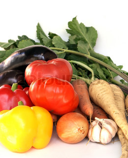 heap of  ripe vegetables against white background