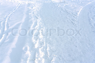 Various trails on the snow-covered land. HDR image