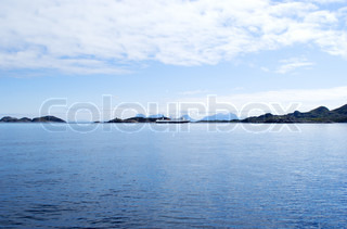 Seascape of Norwegian sea with cloudy sky