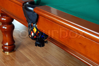 balls in billiards table leather pockets closeup