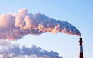 Factory pipe produces smoke in the sky