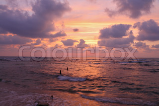 Enchanting sunset on Mediterranean sea. Pink clouds and reflections on the water