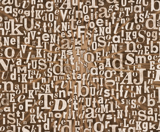 Grunge and gritty background texture made of old printed letters.