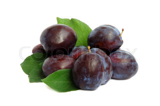 Fruits ripe violet plums with leaves on a white background