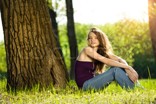 beautiful teen girl in forest smile