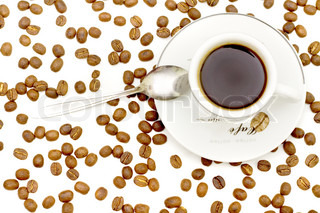 cup of coffee on saucer with scoop