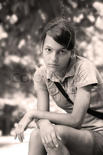teenage girl portrait sitting outdoor in black and white