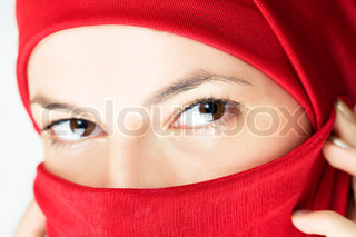 young woman  in red veil, close-up shot