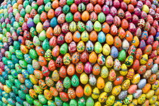 Thousends painted handmade wooden easter eggs, eastern background.