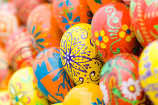 Easter eggs background,close-up shot, focus on the yellow egg with flower.