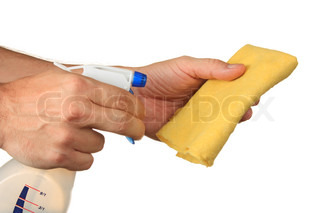 Hand with spray bottle and rag  isolated on a white  background