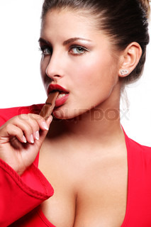 young beautiful woman in red dress eating chocolate
