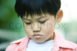 ©James Hardy/AltoPress/Maxppp ; Boy with eyes lowered, portrait