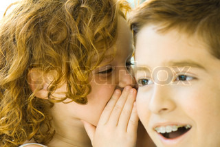 ©Michèle Constantini/AltoPress/Maxppp ; Little girl whispering in her brother's ear, close-up