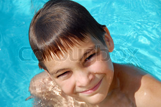 Teen boy in swimming pool portrait