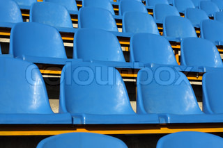 Empty section of blue seats on stadium