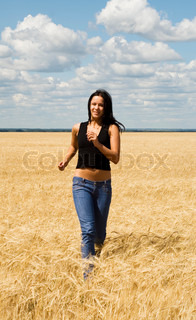a beautiful woman running on a field