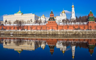 Famous Moscow Kremlin and beautiful reflection in Moskva river, Russia