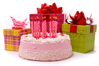 Pink pie with eleven candles and gifts in boxes on a white background