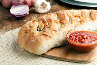 Homemade stromboli or stuffed bread with broccoli potatoes garlic ...