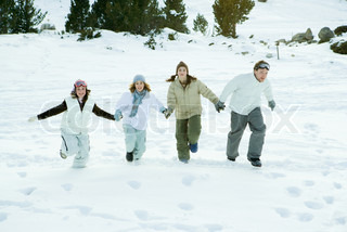 ©Laurence Mouton/AltoPress/Maxppp ; Four young friends running together in snow, holding hands, full length