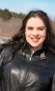happy beautiful woman in leather jacket