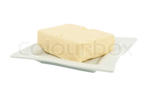 butter on a plate on a white background