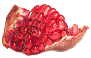 Extreme close up background of a red juicy ripe pomegranate fruit seeds