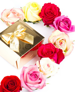 Colorful roses and golden gift on white