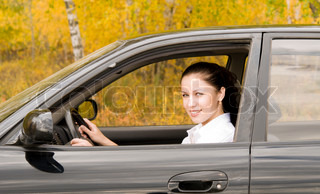 young pretty woman driving her car