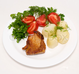 roasted meat with vegetables on white plate