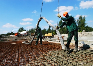 Construction workers laying of the foundation