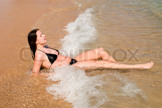 young pretty woman relaxing in the seashore
