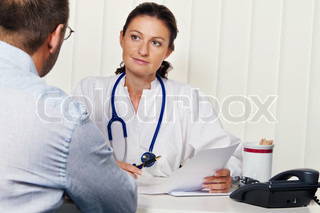 Doctors in medical practice with patients. Discussion and advice for treatment.
