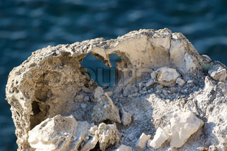 The shape of heart made in stone, sea background.