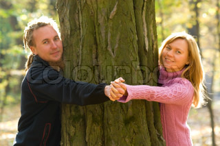 Couple in love relaxing, holding hands together showing there love, focus on hands.