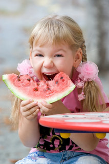 Crazy girl eating watermelon,focus on eyes shot on 135mm optic.