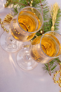 two glasses of champagne and gold christmas decorations