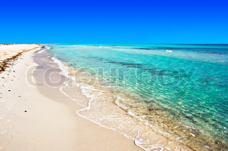 Perfect sunny beach, warm, clear and transparent sea