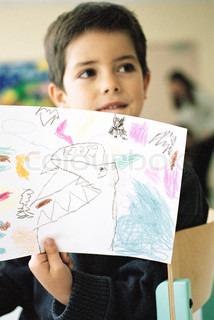 © Laurence Mouton / AltoPress / Maxppp; Boy holde op tegning i klasseværelset