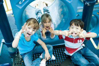 ©Alix Minde/AltoPress/Maxppp ; Children on playground equipment, making faces at camera