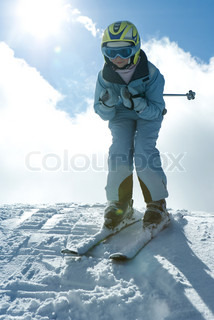 ©Laurence Mouton/AltoPress/Maxppp ; Young skier standing on top of hill, looking at camera, full length portrait