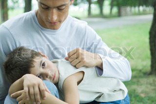 ©Eric Audras/AltoPress/Maxppp ; Boy lying down in father's lap