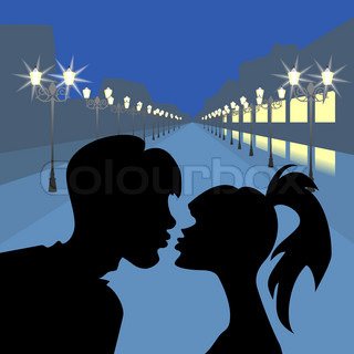 silhouettes kiss a girl and a guy against the evening the boulevard with lanterns