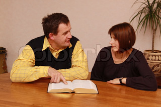 Man and woman reading Bible
