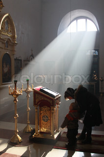 She prays in an Orthodox church. Beautiful light filled the church