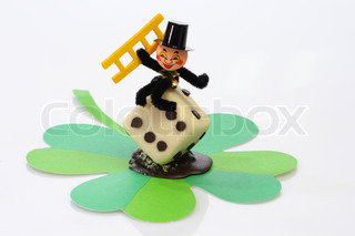 Lucky marzipan pig with cloverleaf and mushroom, on bright background