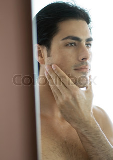 Image of 'man, mirror, looking'