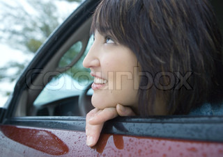 ©Laurence Mouton/AltoPress/Maxppp ; Woman looking out of car window
